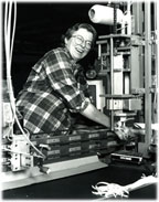 Diane running one of our ribbon cutting machines.